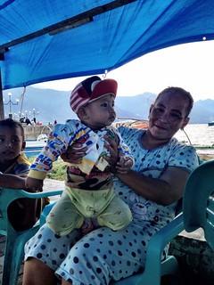 indonesia grandma with baby in palu sulawesi