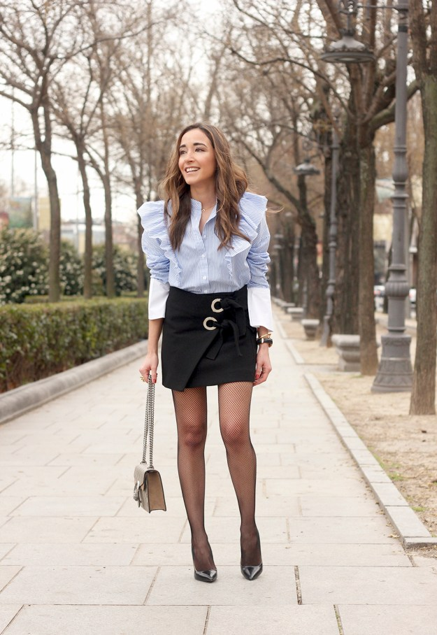 Ruffled striped shirt Fishnet tights black skirt heels gucci bag style fashion outfit 02