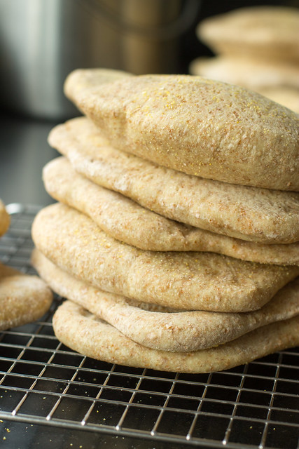 Homemade whole wheat pita bread, soft yet sturdy, with a full pocket just waiting for your falafel, gyro, shwarma, or hummus. Puts store-bought to shame!
