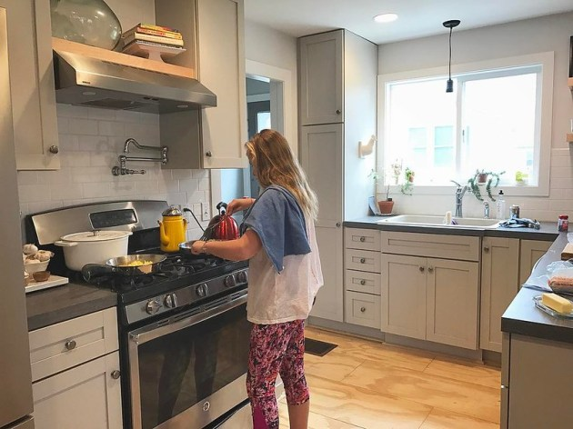 Jessica is making breakfast for her and Oliver this morning. 2 pans on the stove, lots of chopping, using the oven. My favorite part? The towel across her shoulder, just like me. She's fluttering around from counter to counter and every once in a while sh
