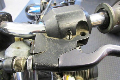 Torn Top Plate Above Clutch Switch on Left Perch