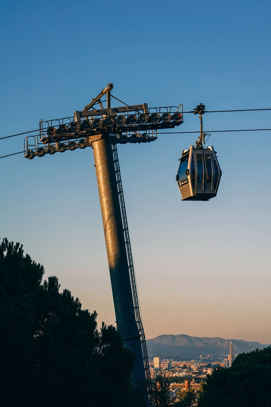 A cable car that cuts across the blue skyline.