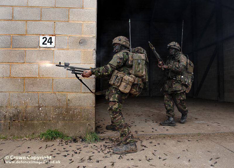 Soldier From 2 Rifles Fires A GPMG During Training Exercis