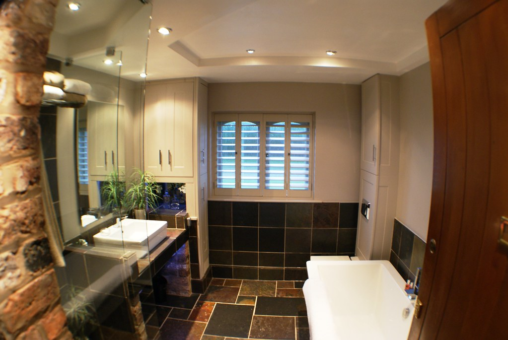 35 Finished A Spacious Bathroom With Plenty Of Storage