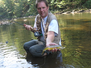 Photo of man holding a brown trout