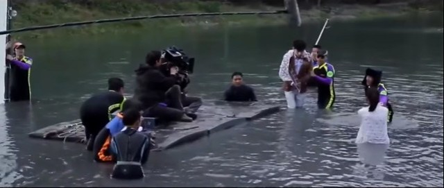 The Mysterious Family Water Scene
