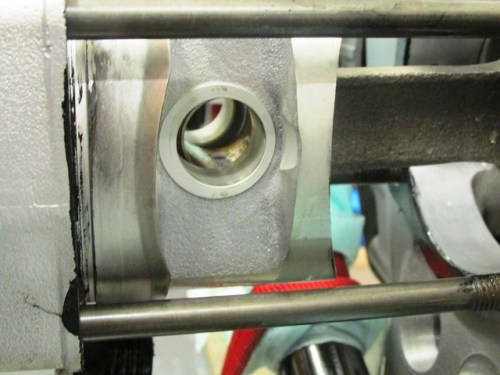 Connecting Rod Inserted Between Piston Bosses