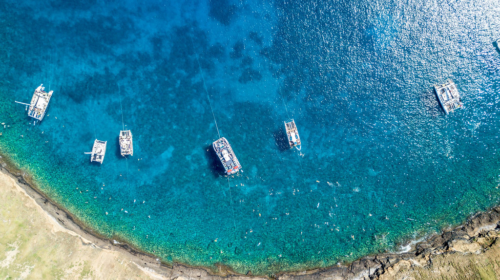 Best place to snorkel in Maui! Molokini Crater with it's beautiful clean blue waters. Check out the best tour! - Maui Travel Tips, Molokini Snorkeling, Things to do Maui | Wanderlustyle.com