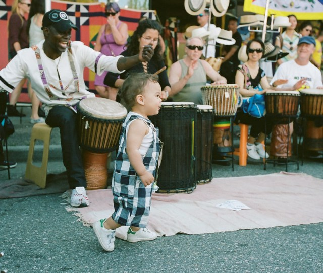 Toddler Dances To Drum Music At Car Free Day By Mark Klotz