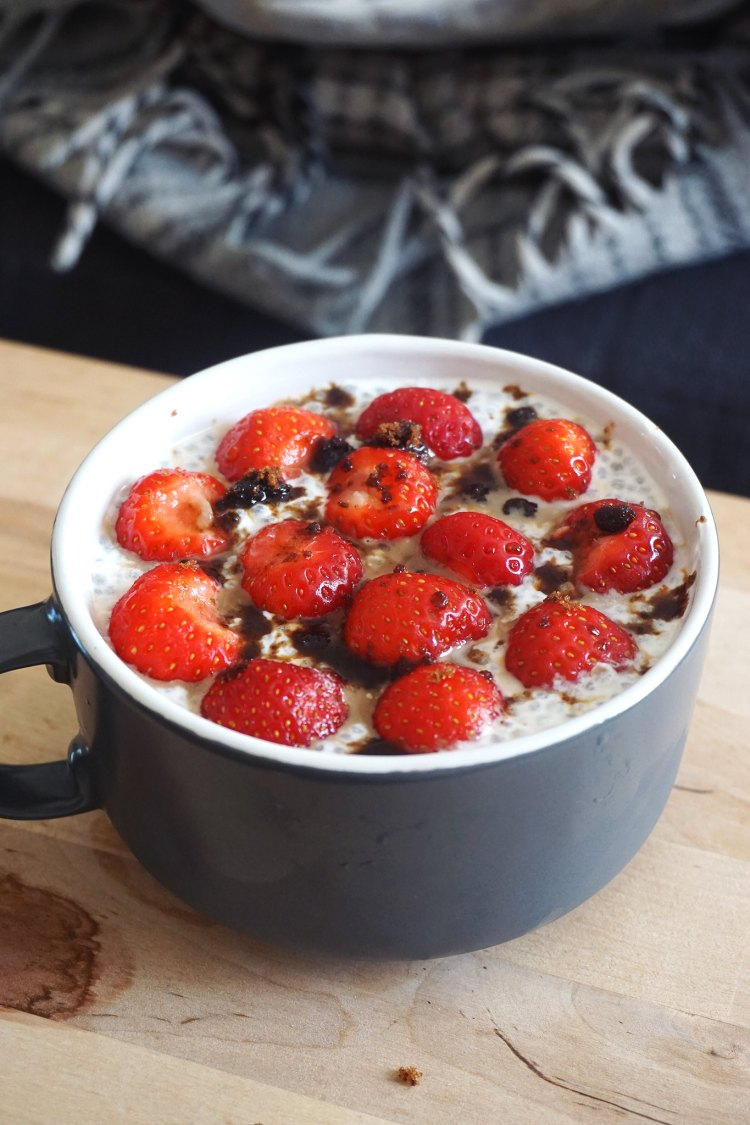 Greek yoghurt based chia pudding with strawberries and dark muscovado