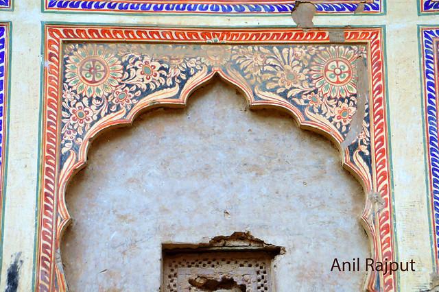 Fresco flower designs inner wall of a haveli in Churu
