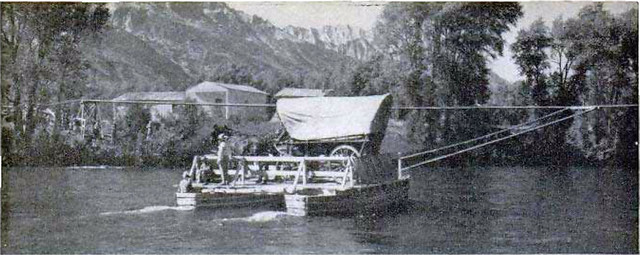 Carrying this old Conestoga wagon and team of horses, the ferry makes its initial trip across the Snake River after the restoration.