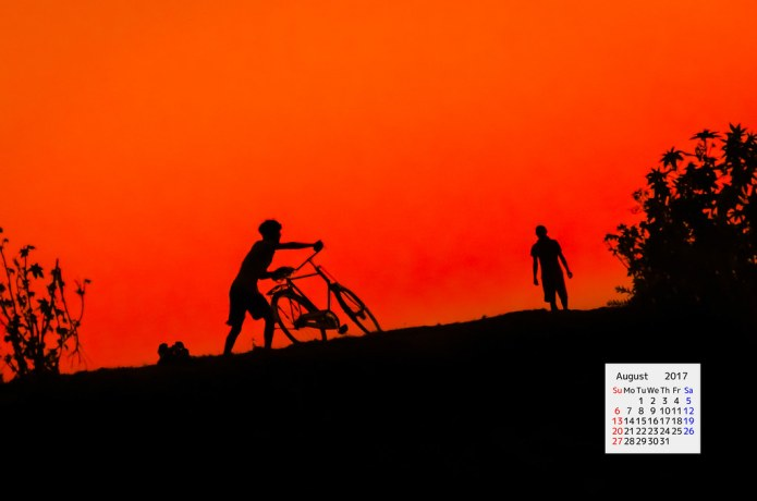 Silhouette of a boy with cycle Majuli Island Assam India