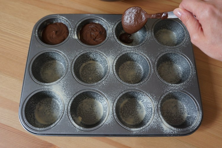 Healthy gluten free black bean brownies with S'mores on top | making process - pouring the batter in a muffin tin
