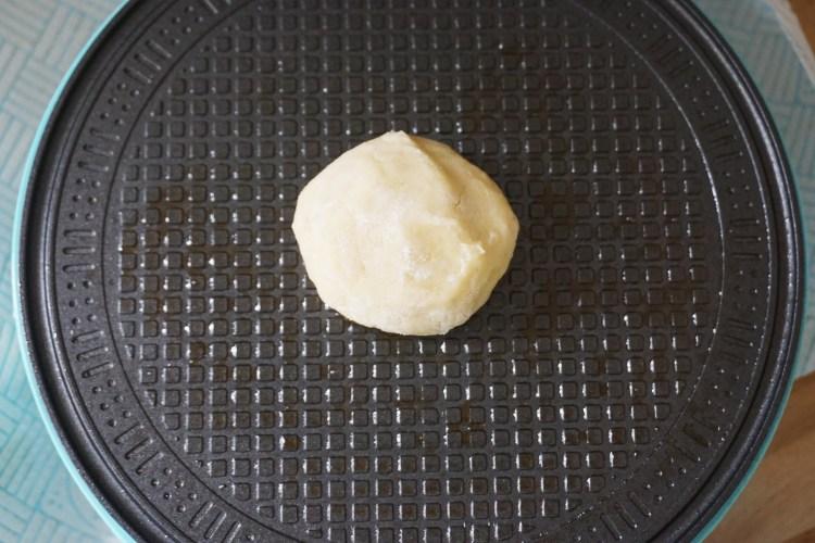 Gluten free Dutch waffles (stroopwafels) making process | dough ball on waffle plate