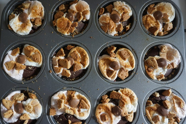 Healthy gluten free black bean brownies with S'mores on top   making process - grilled marshmallows, cookies and chocolate buttons added on top