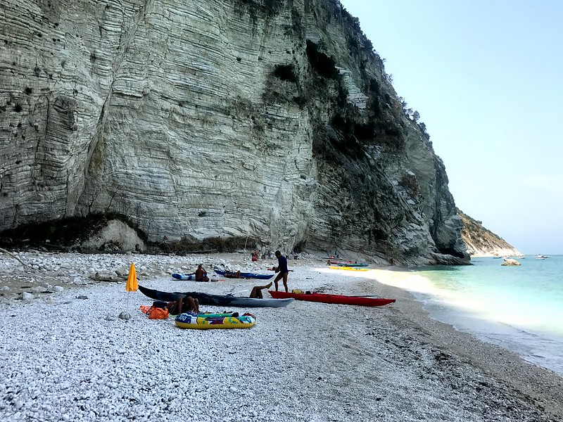 Discovering some paradisal beaches along Mount Conero on canoes.