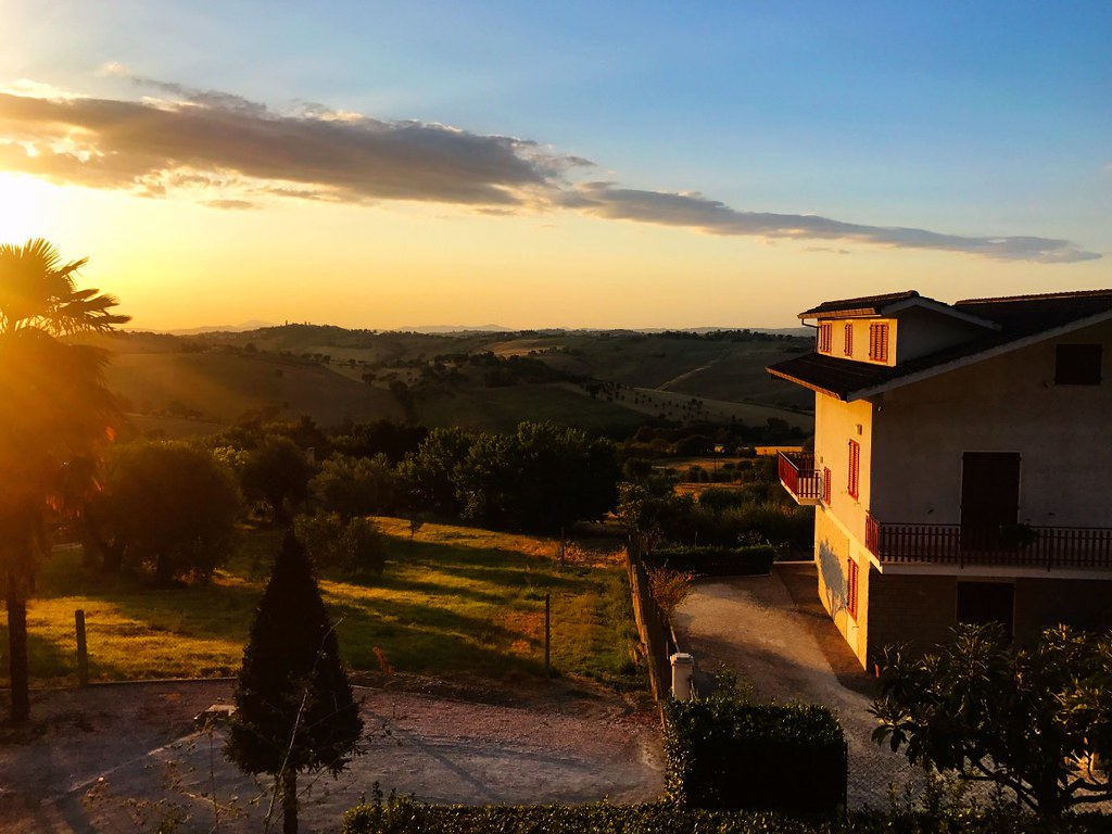 warm sunrise over italian hills in belvedere ostrense village in marche
