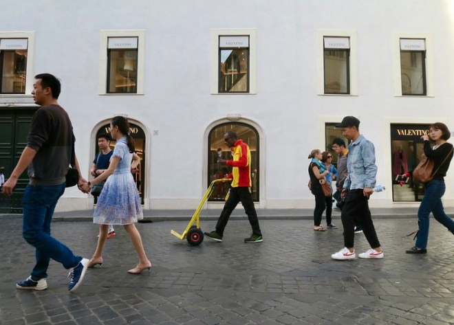 People Passing Valentino Store