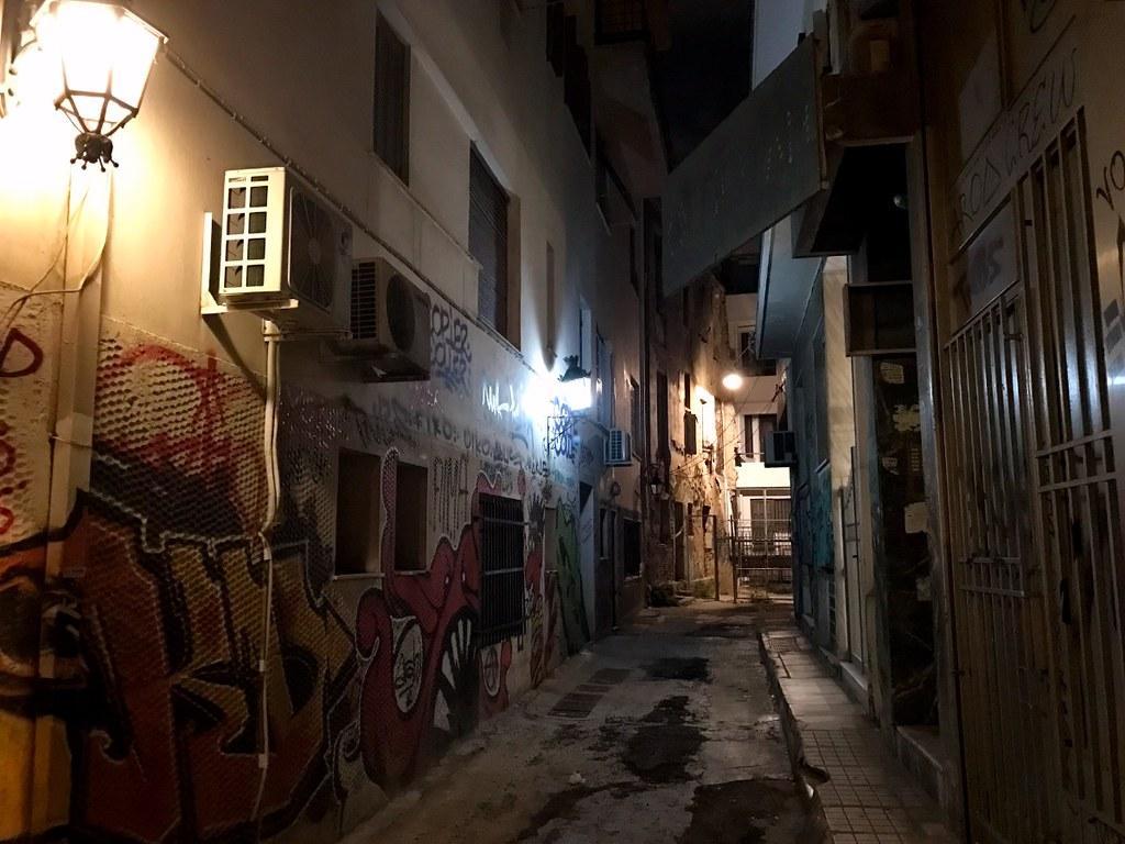 dark narrow street in athens
