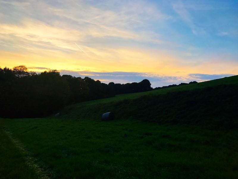 sunset over green fields in saxon switzerland
