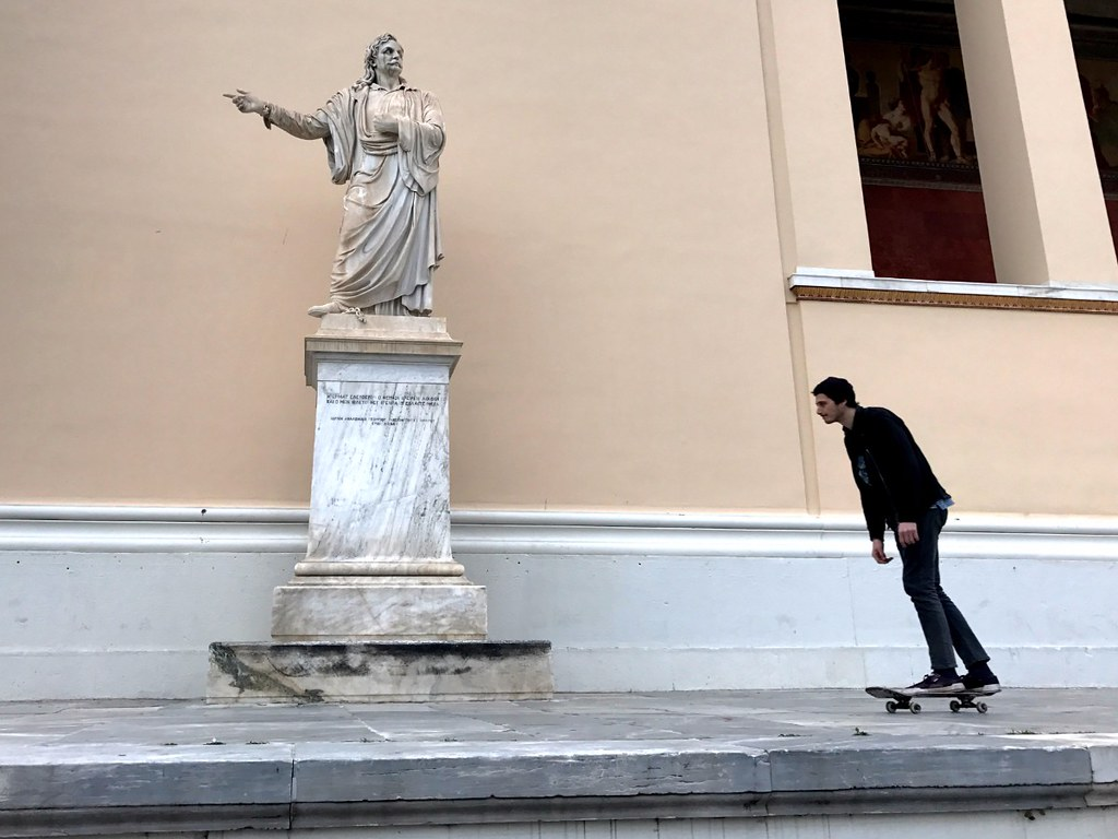 skater about to grind on statue in front of the greek parliament