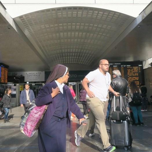 Nun watching man running in train station