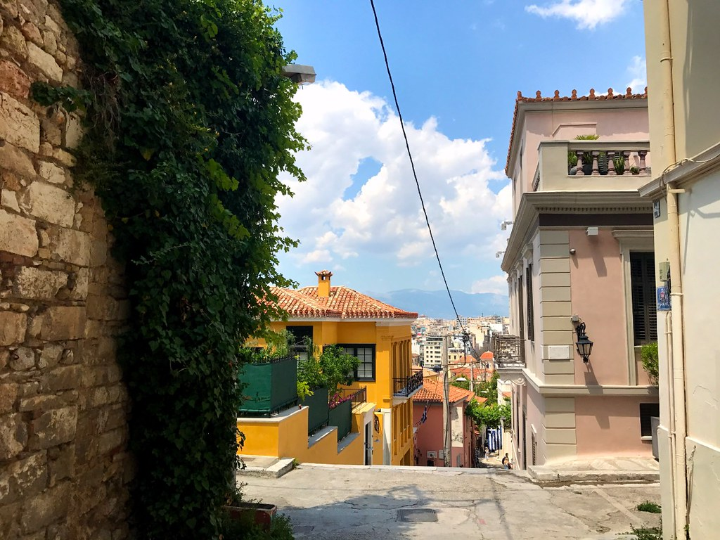 colorful houses and ivy on stone wall in plaka athens
