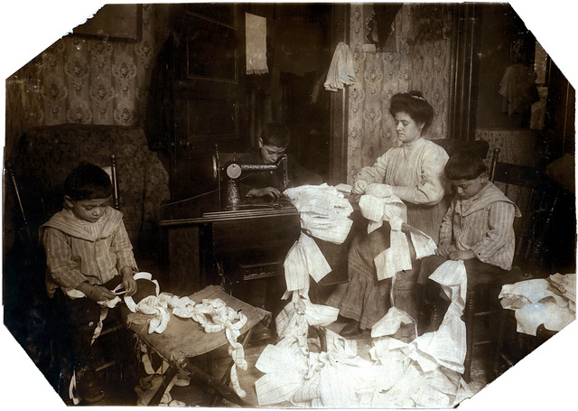 Making dresses for Campbell Kid Dolls in a dirty tenement room