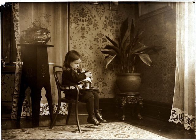 Putting a Campbell Kid doll to sleep. March 1912