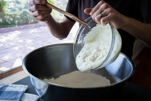 adding the ricotta and eggs to the flour