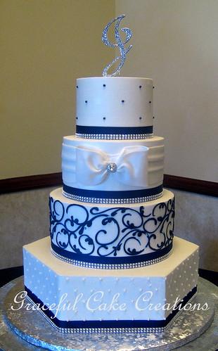 Elegant White Butter Cream Wedding Cake With Navy Blue Scr
