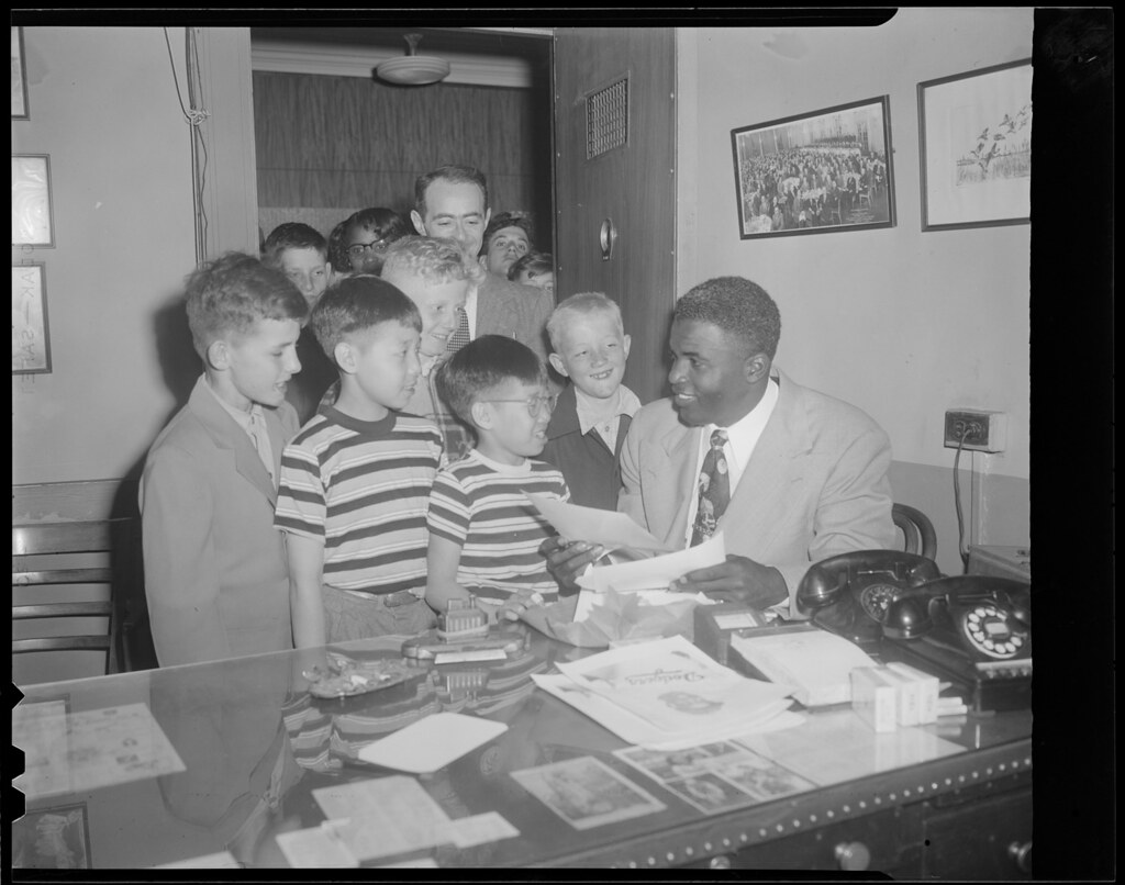 Jackie Robinson Signs Autographs For Kidfans