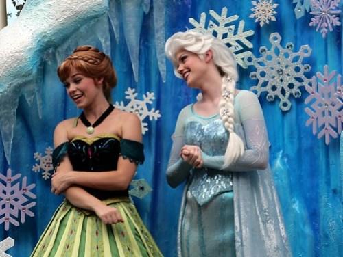 Anna and Elsa from Frozen in Disney Festival of Fantasy Parade at the Magic Kingdom - Walt Disney World (Closeup)