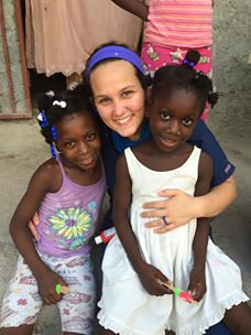 Taylor with little girls in Haiti