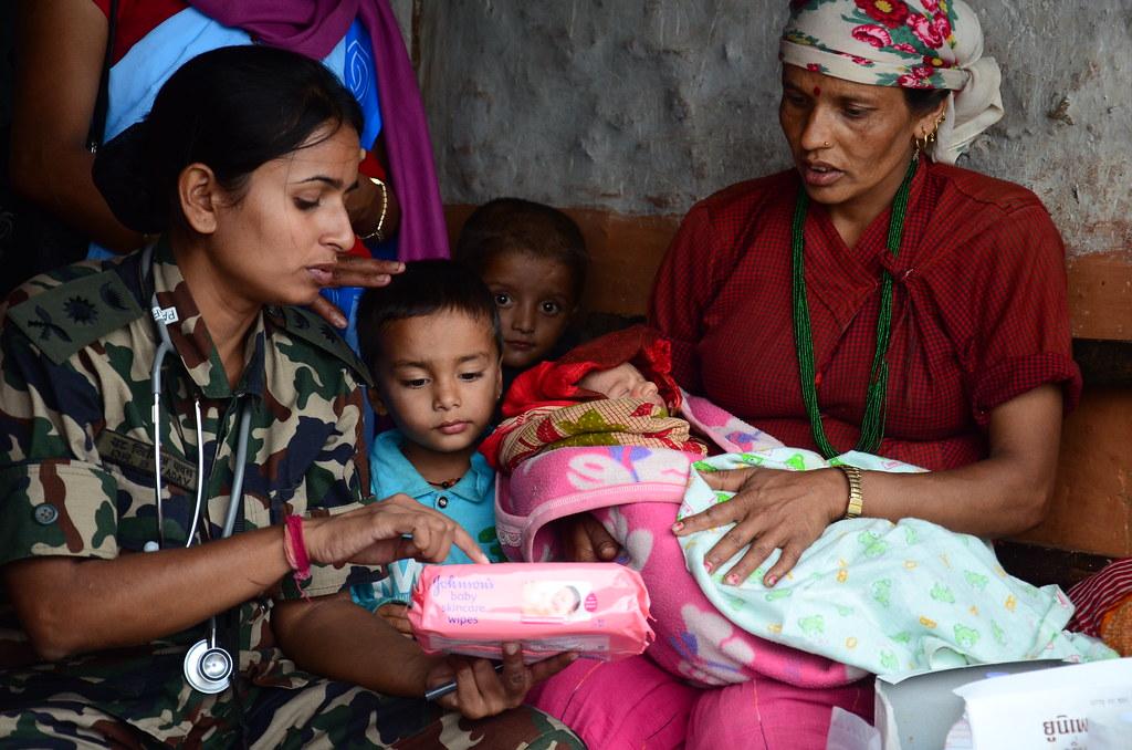 120914 X Xxxxx 002 A Nepali Woman Listens To Infant Care
