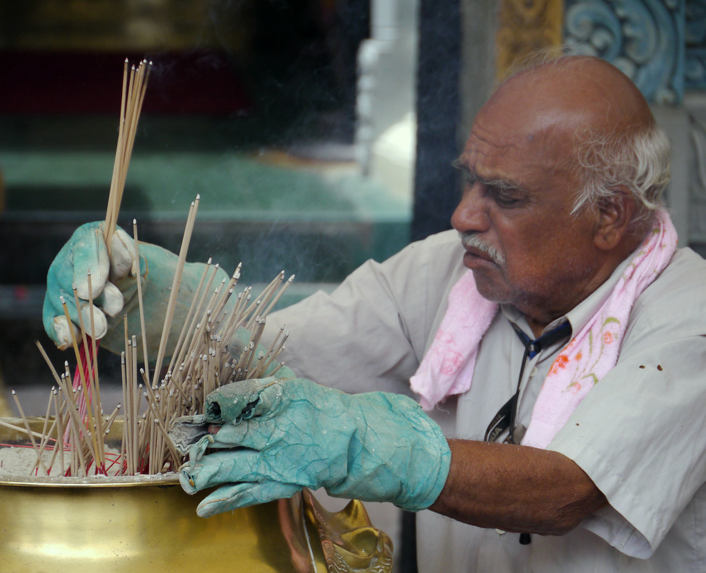 Old Man Working At An Indian Temple In Singapore Ad