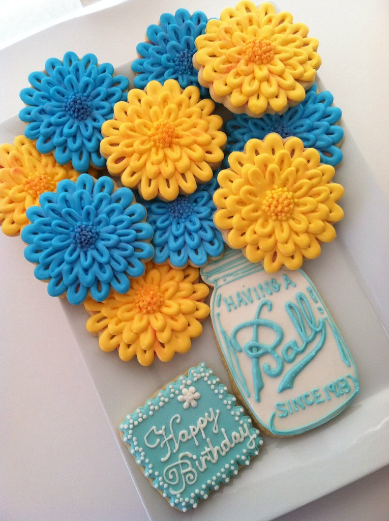 Blue And Yellow Zennias In A Mason Jar Design By