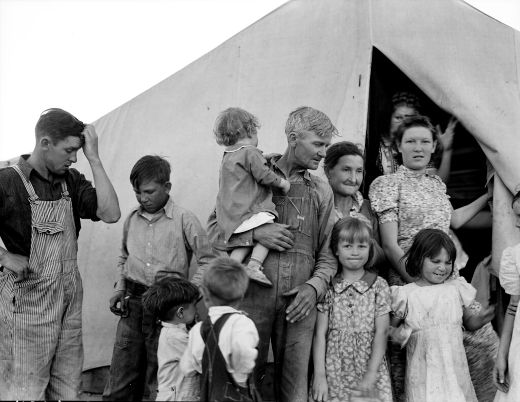 "Lange, Dorothea, photographer. In Farm Security Administration FSA migrant labor camp during pea harvest. Family from Oklahoma with eleven children. Father, eldest daughter and eldest son working. She: ""I want to go back to where we can live happy, live decent, and grow what we eat."" He: ""I've made my mistake and now we can't go back. I've got nothing to farm with."" Brawley, Imperial County, California. Feb, 1939."