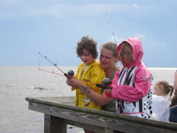 Photo of other fishing with children from pier