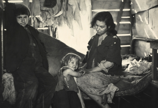 Interior of wood shack built upon Ford truck chassis housing father, mother and seven children. This view shows the mother and two of her children. They were found on U.S. Route 70, between Bruceton and Camden, Tennessee, near Tennessee River –The Bitter Years 007
