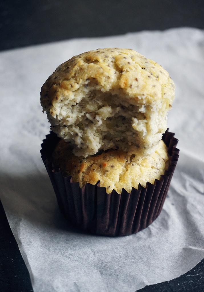 Two gluten free cheddar, corn and chia muffins piled on top of each other - gluten free corn chia muffins