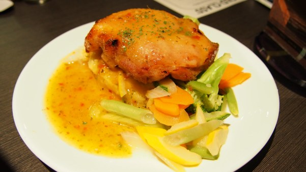 The Thai Grilled Chicken Thigh is served with a piquant sweet and sour sauce and a generous side of steamed veggies.