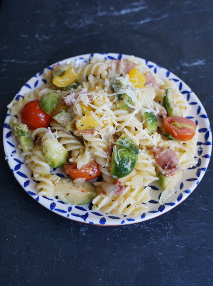 Gluten free breakfast pasta with bacon, cheese and vegetables