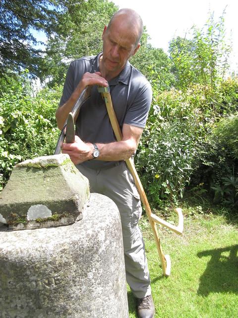 Sharpening a scythe left handed