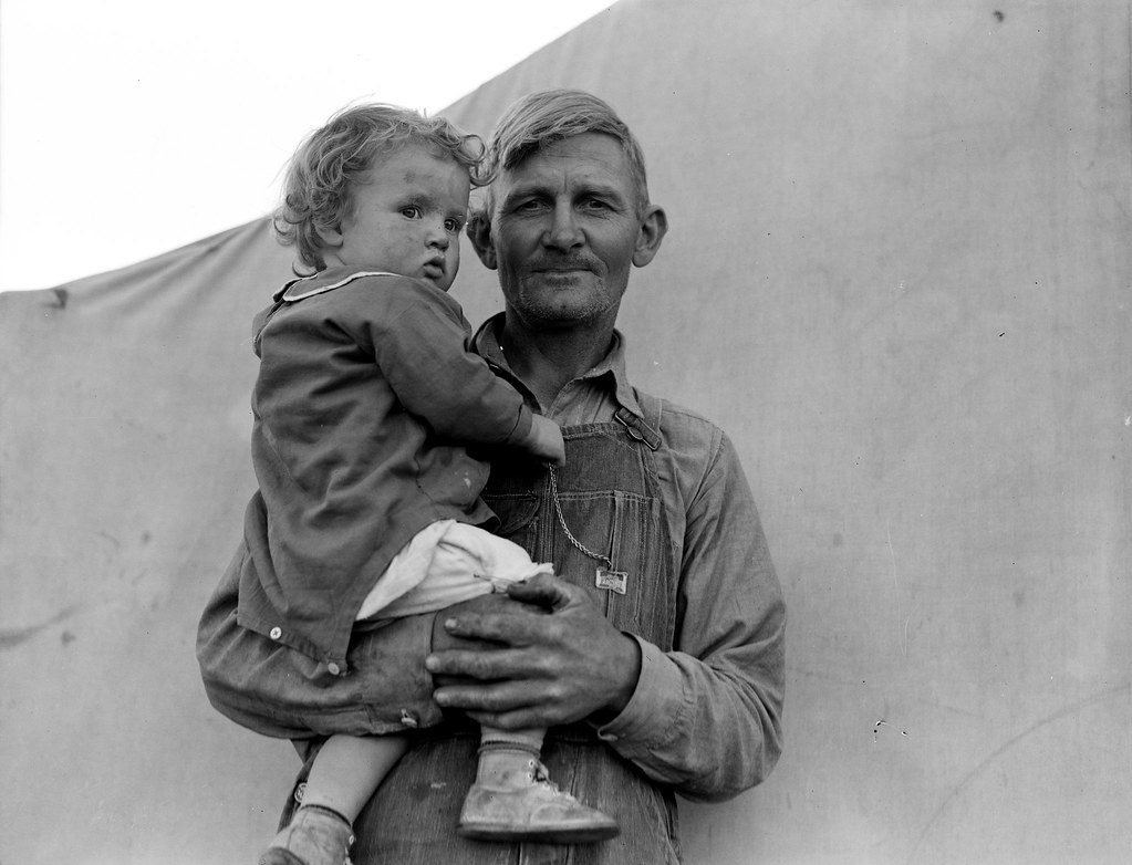 Migrant father and daughter - Brawley, Imperial Valley, In Farm Security Administration FSA migratory labor camp. Feb, 1939. Photo by Dorothea Lange.