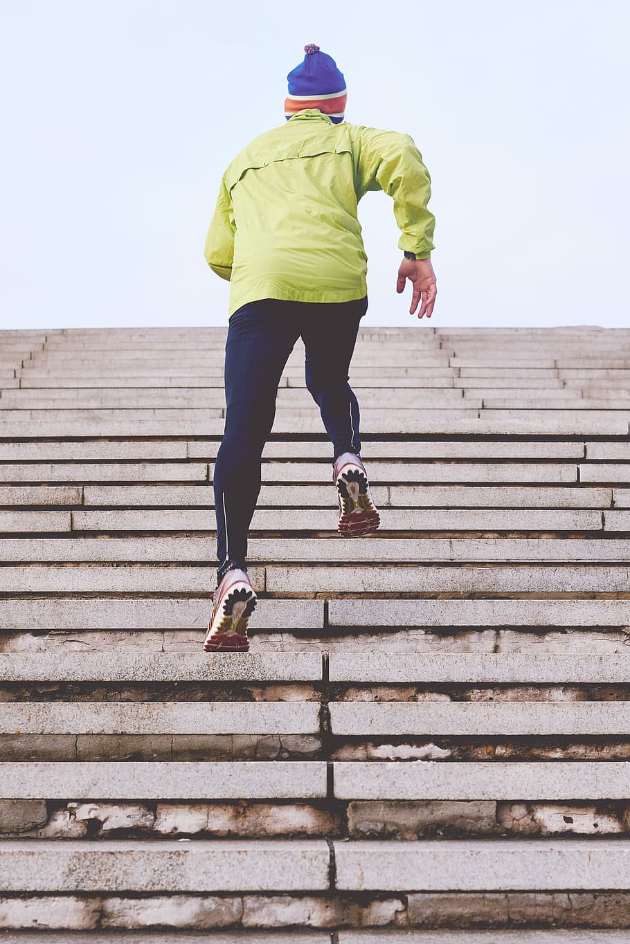 person climbing concrete stairs, man wearing green jacket climbing on stairs HD wallpaper