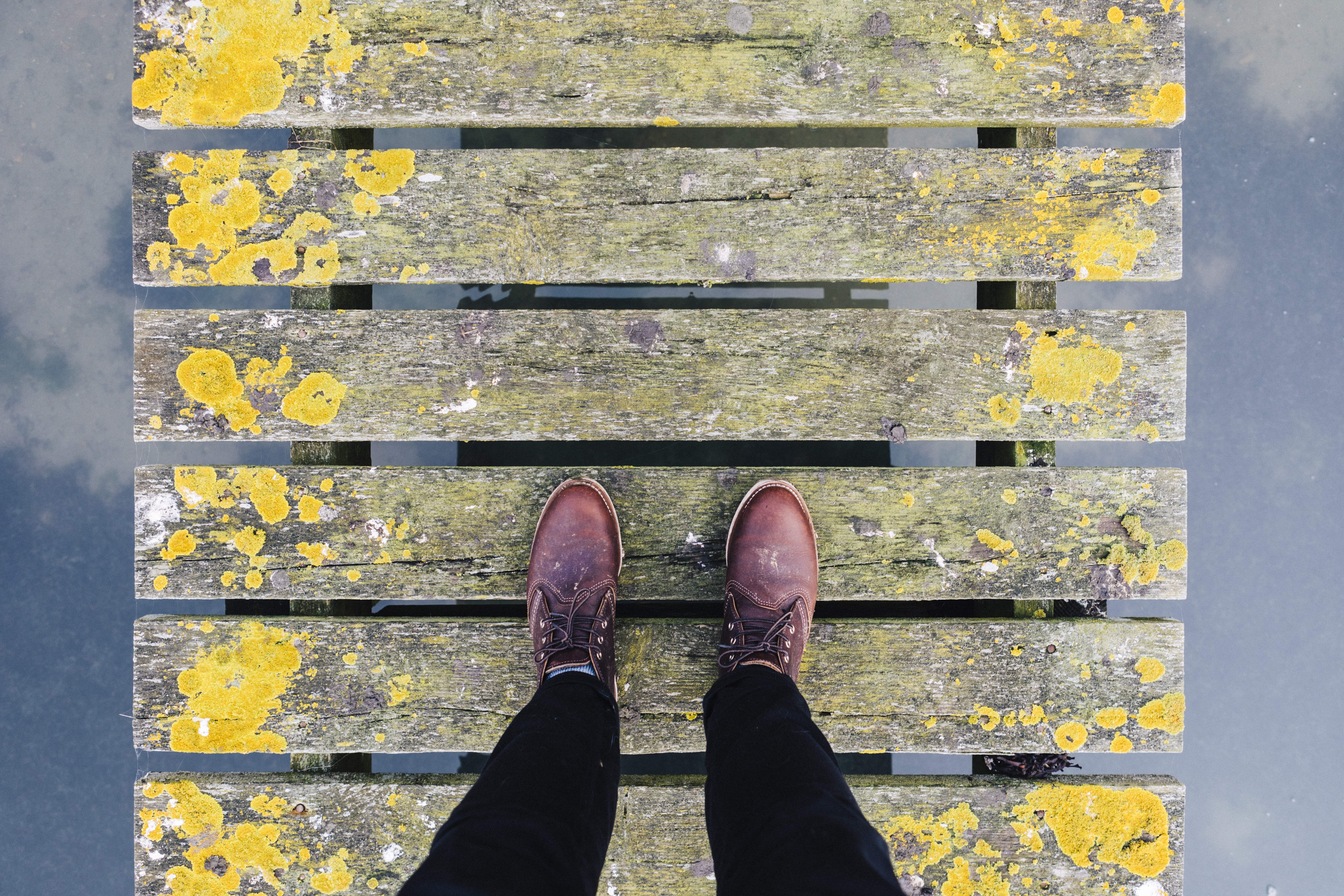 Person Standing On Beige And Yellow Wooden Pallet Free