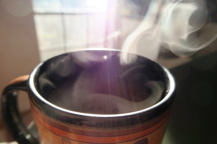 A curl of steam on my tea makes an