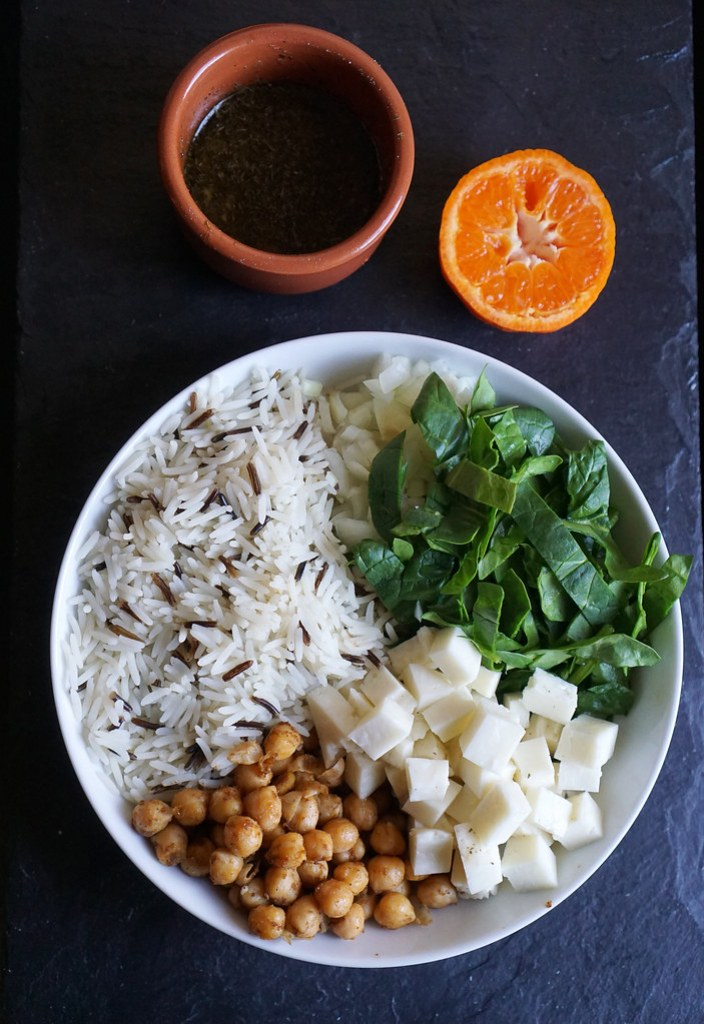 Curried chickpeas and halloumi rice salad with a clementine dressing